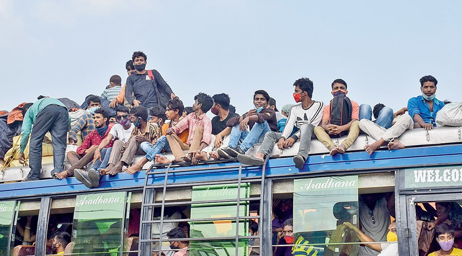 student travelling over bus roof