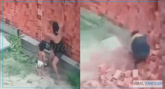 mother saved child from bricks wall